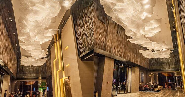 custom lighting ultimate guide - hotel lobby chandelier