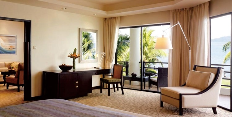 Adjustable hotel floor lamp in hotel guest room
