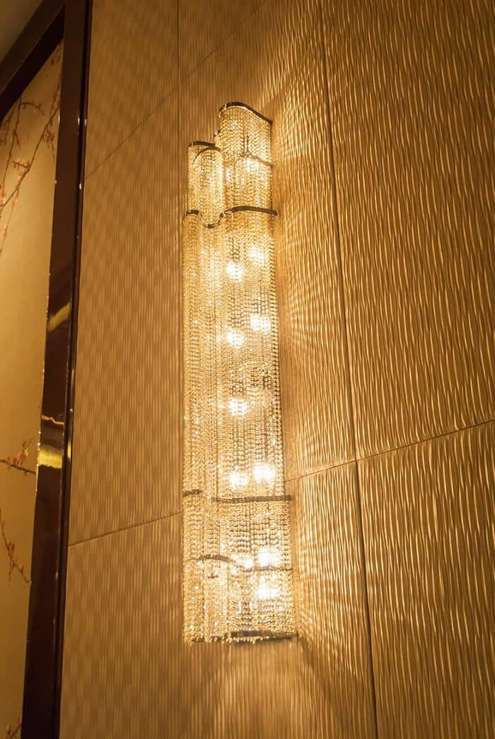 Crystal custom wall light for hospitality projects