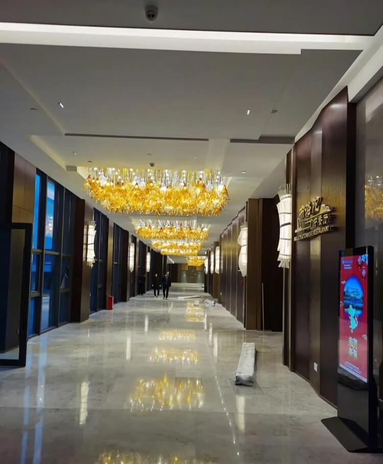 Custom chandelier in hotel hallway, Wyndham Resort, Baise China