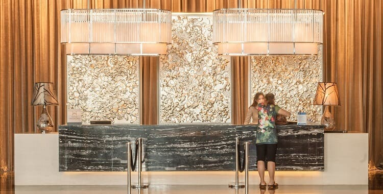 Glass hotel accent table lamp in reception desk