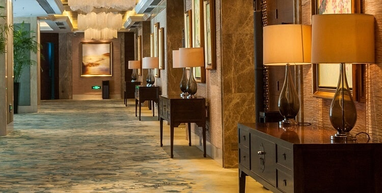Glass hotel table lamp in hallway area